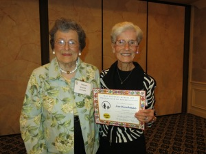 50 year Auxiliary Member Sue Hirschman (right) paused from visiting withlong-time member Wanda Fortune.