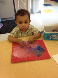 Day Nursery Federal Center toddlers paint with red white and blue